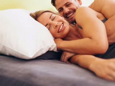 Caucasian Couple Smiling In Bed Together
